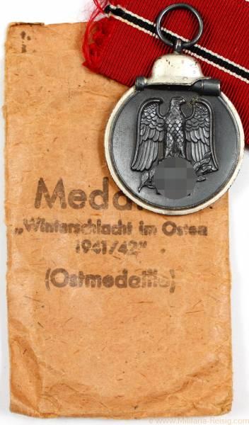 Ostmedaille mit Verleihungstüte, Herst. Metall & Kunststoff, Gablonz